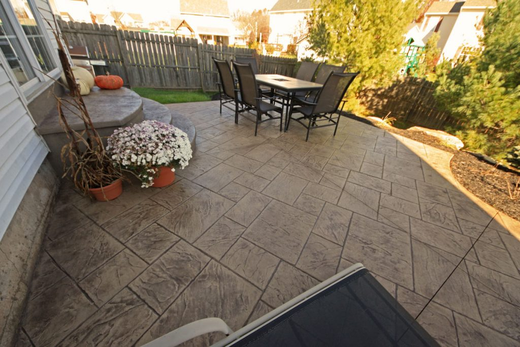 A stamped concrete patio and steps